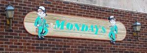Sign above Mondays restaurant